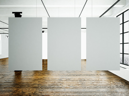 Photo pour Photo of museum interior in modern building.Open space studio. Empty white canvas hanging.Wood floor, bricks wall,panoramic windows. Blank frames ready for bussiness information.Horizontal. - image libre de droit