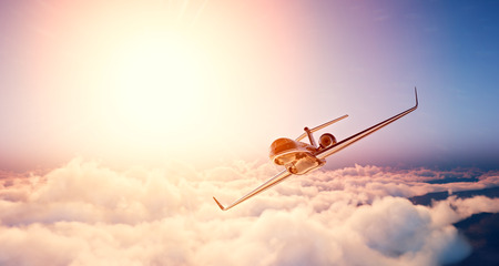 Photo for Image of black luxury generic design private jet flying in blue sky at sunset. Huge white clouds and sun background. Business travel concept. Horizontal , front view. - Royalty Free Image