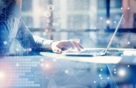 Foto de Man Typing Keyboard Laptop Hand.Project Manager Researching Process.Business Team Working Startup modern Office.Global Strategy Virtual Icon.Innovation Graphs Interfaces.Analyze market stock.Blurred - Imagen libre de derechos