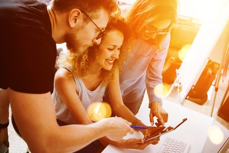 Foto de Coworkers Making Great Startup Decisions.Young Business Marketing Team Discussion Corporate Work Concept Modern Office.New Creative Idea Presentation.Woman Touching Digital Tablet Screen.Flare Effect - Imagen libre de derechos
