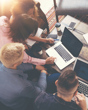 Foto de Group Young Coworkers Making Great Business Decisions.Creative Team Discussion Corporate Work Concept Modern Office.Startup Marketing Idea Presentation.Woman Touching Digital Laptop.Top View.Vertical - Imagen libre de derechos