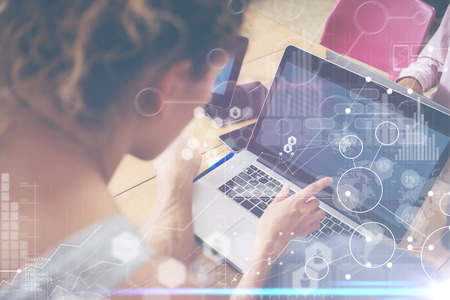 Foto de Woman Working Modern Desktop Notebook Wood Table Concept.Account Manager Researching Process.Business Team Startup Croworking People Sharing Office.Global Strategy Virtual Icon Graph Interface.Blurred - Imagen libre de derechos
