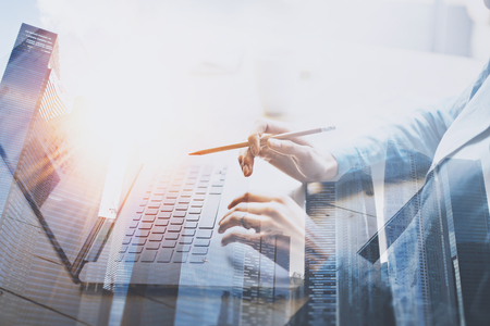 Photo for Businesswoman working at modern office on laptop.Young woman working at the wooden table with notebook.Blurred background.Double exposure horizontal. - Royalty Free Image