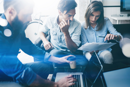 Foto de Teamwork process concept.Young coworkers work with new project in office.Horizontal, blurred background. - Imagen libre de derechos
