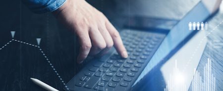 Photo for Businessman using tablet device and electronic pen stylus while working at office.Closeup view of male hands pointing tablet screen and typing keyboard. Wide format. - Royalty Free Image