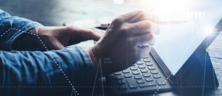 Photo for Close-up view of male hands typing on electronic tablet keyboard-dock station. Businessman working at office and using electronic pen and device. Wide format. - Royalty Free Image