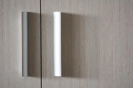 Photo for Background wooden texture door with plastic metallic handles. - Royalty Free Image