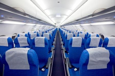 Cabin with empty chairs in the airplane