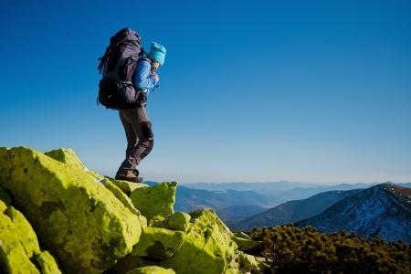 Photo pour Hiker walking in autumn mountains  Caucasian model outdoors in nature - image libre de droit