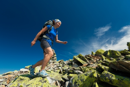 Photo for Hiker jumps over stones in Carpathian mountains - Royalty Free Image
