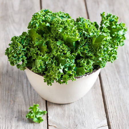 Photo for Fresh green kale in ceramic bowl. Selective focus. - Royalty Free Image