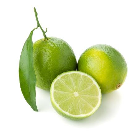 Foto de Two and half ripe limes. Isolated on white - Imagen libre de derechos