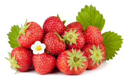 Foto de Strawberry fruits with flowers and green leaves. Isolated on white background - Imagen libre de derechos