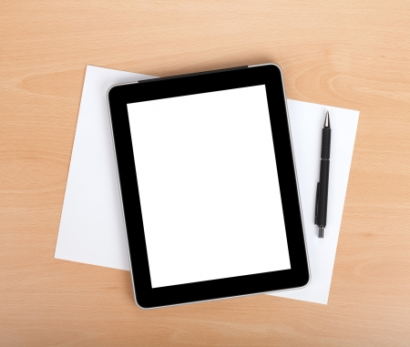 Foto de Tablet with blank screen and pen over white papers. View from above - Imagen libre de derechos