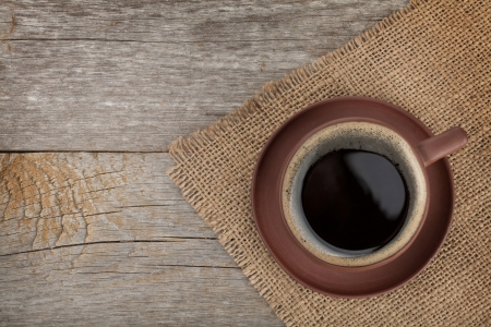 Photo pour Coffee cup on wooden table texture. View from above - image libre de droit