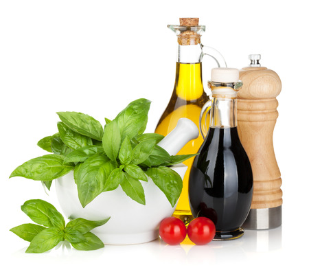 Photo pour Olive oil, vinegar bottles with basil and tomatoes. Isolated on white background - image libre de droit