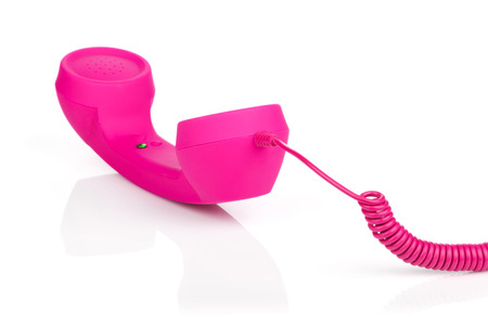 Photo pour Pink vintage telephone. Isolated on white background - image libre de droit