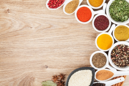 Photo for Various spices selection on wooden table - Royalty Free Image