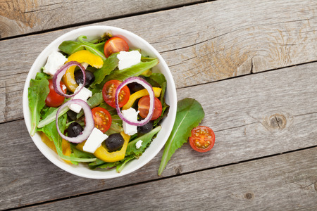 Photo for Fresh healthy salad on wooden table.  - Royalty Free Image