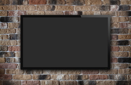 Foto de TV display on old brick wall background - Imagen libre de derechos