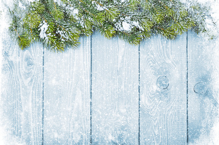 Foto de Old wood texture with snow and firtree christmas background - Imagen libre de derechos