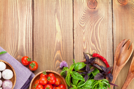 Photo for Fresh farmers tomatoes and basil on wood table. View from above with copy space - Royalty Free Image