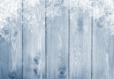 Foto de Blue wood texture with snow christmas background - Imagen libre de derechos