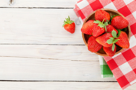 Photo for Fresh ripe strawberry in bowl over wooden table background. Top view with copy space - Royalty Free Image