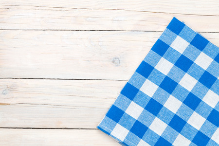 Photo pour Blue towel over wooden kitchen table. View from above with copy space - image libre de droit