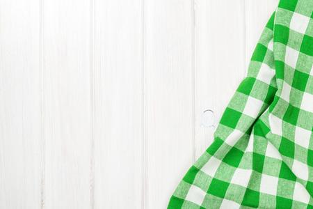 Foto de Green towel over wooden kitchen table. View from above with copy space - Imagen libre de derechos