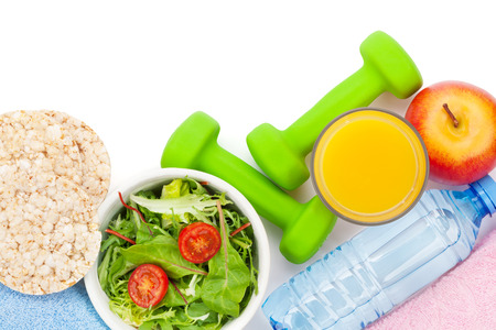 Foto de Dumbells, healthy food and towels. Fitness and health. Isolated on white background - Imagen libre de derechos