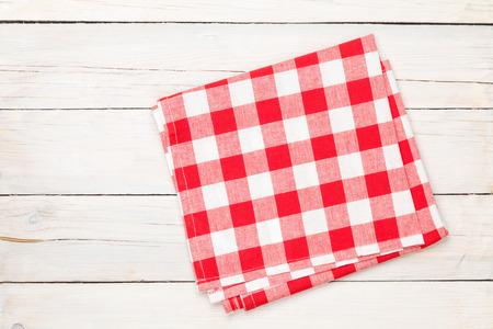 Foto de Red towel over wooden kitchen table. View from above with copy space - Imagen libre de derechos