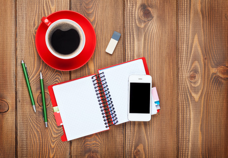 Photo pour Office desk table with supplies and coffee cup. Top view with copy space - image libre de droit