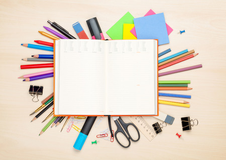 Foto de Blank notepad over school and office supplies on office table. Top view with copy space - Imagen libre de derechos