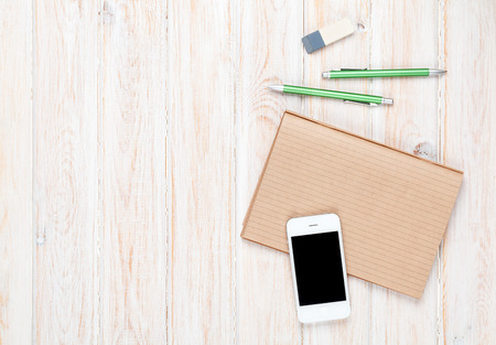 Photo pour Office desk table with supplies and smartphone. Top view with copy space - image libre de droit