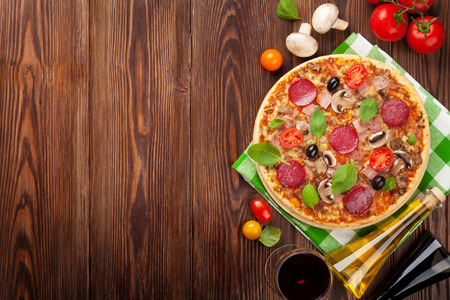 Photo for Pizza and red wine on wooden table background. Top view with copy space - Royalty Free Image