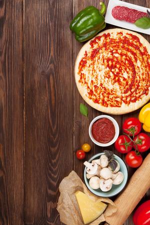 Foto de Pizza cooking ingredients. Top view with copy space - Imagen libre de derechos