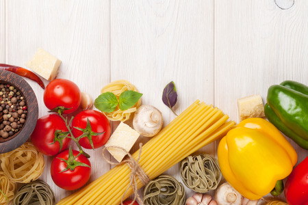Photo pour Italian food cooking ingredients. Pasta, vegetables, spices. Top view with copy space - image libre de droit