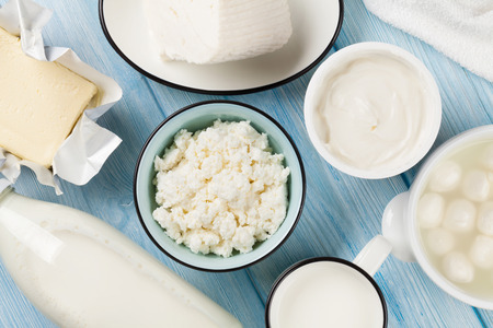 Photo for Dairy products on wooden table. Sour cream, milk, cheese, egg, yogurt and butter. Top view - Royalty Free Image