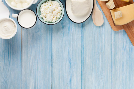 Photo for Dairy products on wooden table. Sour cream, milk, cheese, egg, yogurt and butter. Top view with copy space - Royalty Free Image