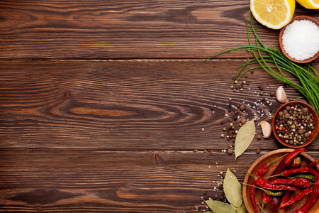 Photo for Various spices on wooden background. Top view with copy space - Royalty Free Image