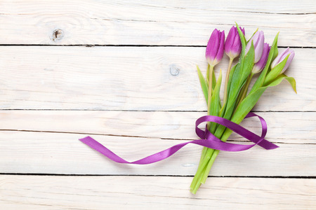 Photo for Purple tulips over wooden table. Top view with copy space - Royalty Free Image