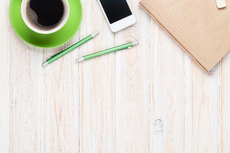 Foto de Office desk table with supplies and coffee cup. Top view with copy space - Imagen libre de derechos