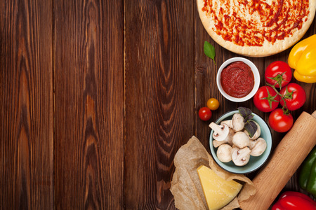 Foto de Pizza cooking ingredients. Dough, vegetables and spices. Top view with copy space - Imagen libre de derechos