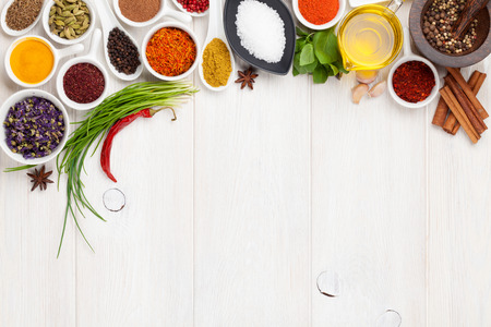 Photo pour Various spices on white wooden background. Top view with copy space - image libre de droit