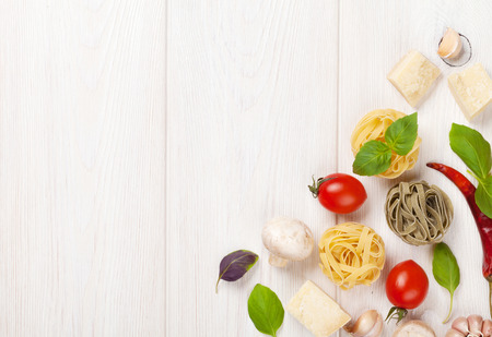 Photo for Italian food cooking ingredients. Pasta, vegetables, spices. Top view with copy space - Royalty Free Image
