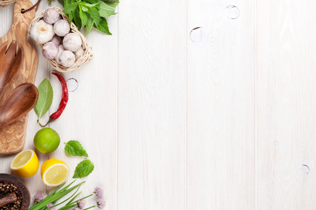 Photo for Fresh herbs and spices on wooden table. Top view with copy space - Royalty Free Image