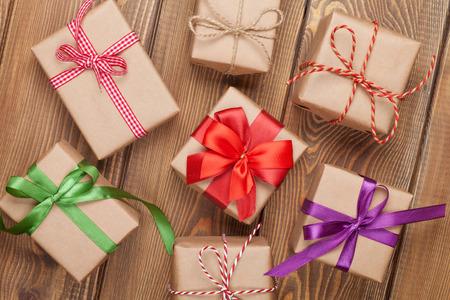 Foto de Gift boxes on wooden table background with copy space - Imagen libre de derechos