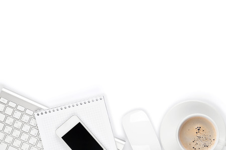 Foto de Office desk table with computer, supplies and coffee cup. Isolated on white background - Imagen libre de derechos