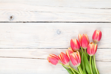 Photo for Colorful tulips on wooden table. Top view with copy space - Royalty Free Image